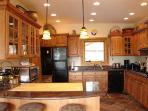 kitchen and 3 seat granite kitchen island with gas cook top and griddle grill