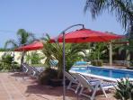 Sun Loungers & Sun Shades Overlooking The Heated Pool