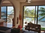 Relish the spectacular view of the Caribbean through floor to ceiling windows
