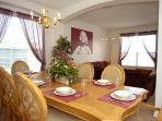 Comfortable dining area with seating for 8