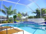 The Sparkling Pool & Spa with Comfortable Sun Loungers