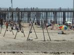 Outside our gate, swings on the beach
