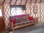 24 ft. Yurt- Queen futon couch bed in living room