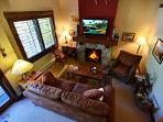 Unwind by the fireplace and flat screen TV