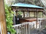 outside jacuzzi sits six and is covered with skylight which is nice even when raining