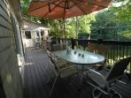 Lake Front Deck has 2 tables w umbrellas & movable seating for 12 . Sunroom entrance is in the rear.