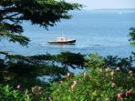 Lobster boat on bay from the lawn