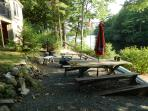 Below the deck is the patio with fire bowl & a picnic table for 8.  Love those roasted smores.