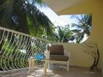 Roomy front balcony where you can relax with a fav book while enjoying the tropical breezes + vistas