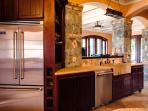 Gourmet kitchen featuring Viking refrigerator and every kitchen need.