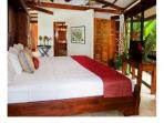 Open bedroom with king bed