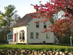 Haven Homeplace in the Spring with Apple Blossoms