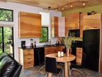Kitchen with black granite and birch custom inlay cabinets