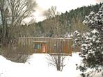 Taos Rio House with forest beyond winter 2010