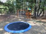 A ground level trampoline and play set for the kids