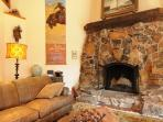 A large rock fireplace is the focal point in the living room