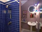 Newly renovated cobalt tiled bathroom