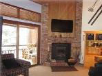 LIVING ROOM with wonderful Fireplace and 55' flat screen 'smart' TV