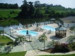 Balcony overlooks pools and lake