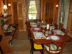 Eat outside on the porch or dine in our cozy dining room with views of the lake and the woods.