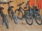 4 mountain bikes with helmets and pump