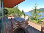 Dine on the deck overlooking East Sound.
