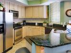 Gourmet kitchen with Stainless Steel Appliances and Granite flows to the Great Room and Living area!