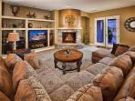 Spacious living room with charming fireplace!
