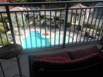 Patio Balcony, entry from Living Room/Queen Bedroom, overlooks Pool area
