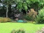 The lovely enclosed garden with a sand pit for children