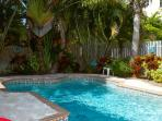 The backyard is tropically landscaped and offers privacy.