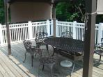Upper rear deck, awning over table and chairs, BBQ/grill