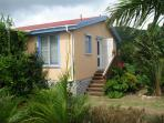 Bright Caribbean colors adorn the exterior of the house. The lot is flat - no stairs or steep grades