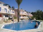 Paradise Gardens complex with large shared pool, set in landscaped gardens