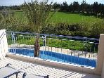 View of the pool from the roof terrace with countryside beyond
