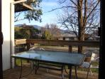 Sun deck off kitchen/dinning. Ideal for a late spring breakfast or sunny afternoon in winter