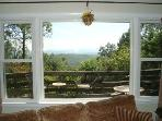 Living Room has fabulous views!  Just outside is 1 of 2 patios with tables & chairs.