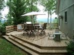 Back Deck off Kitchen with view to North. Patio tables & chairs for adults & kids. Gas Grill