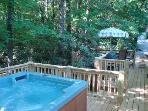 The Romantic Twin Creek Cottage is nestled beside a lush Rhododendron Forest; Stairs lead to Creek