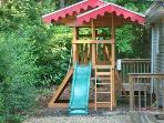 There is a fun outside playground with swings, slide, climbing wall and fort.