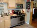 New Kitchen Appliances - shown are dishwasher, gas stove, microwave;