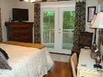 Plush Queen Bed, HDTV, Writing Desk; French Doors to Back Deck, Hot Tub, Patio Table & Chairs, Grill
