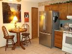 Kitchen has upscale stainless refrigerator with french doors & bottom freezer drawer