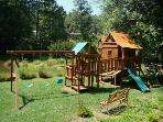 Playground with Forts, Swings, Slides, Climbing Rope Wall, Tire Swing, Clatter Bridge, Picnic Table