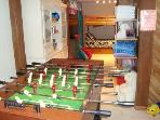 Professional Foosball Table in Play Area looks into Dorm Bedroom