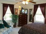 Romantic Queen Bedroom (Main Level): Plush Mattress & Sumptuous Bedding, Love Seat, TV/VCR,