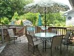 There are several decks with patio tables & chairs to enjoy the private back yard
