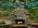 LARGE WDOD BURNING FIREPLACE MADE FROM 'CREEK ROCK W/ GAS STARTER