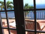 View over deck to ocean from master bedroom
