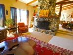 The river rock fireplace in the living room and adjoining dining area of the Suite